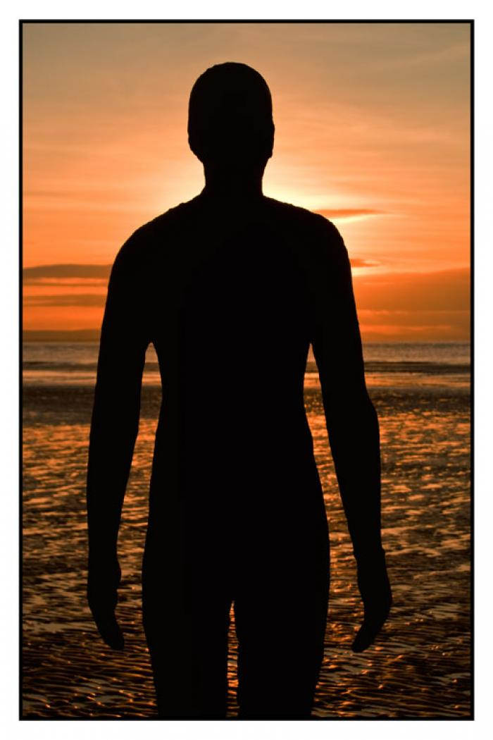 Fiery sunset silhouette, Another Place, Crosby Beach