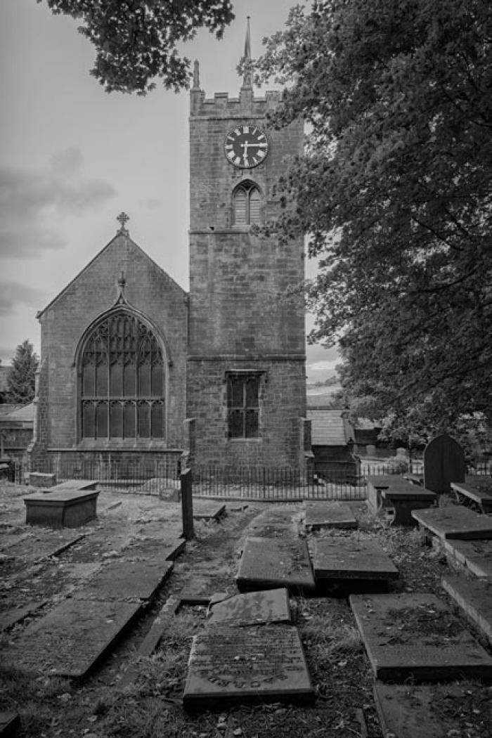 Old graves and St Michael and All Angels Church, Haworth