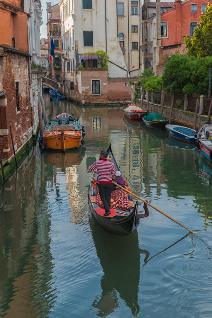 Gondolier negotiating a backwater Venetian Canal